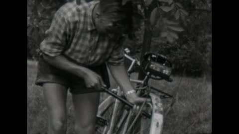 10th school class makes a trip with their bicycles in east - thüringen, young boy inflate air in the tires / shot in 1957 - weimar stock videos & royalty-free footage