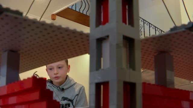 year-old boy builds fan following by building football stadiums out of lego bricks; england: west sussex: crawley: int **joe bryant interview... - オフビート点の映像素材/bロール