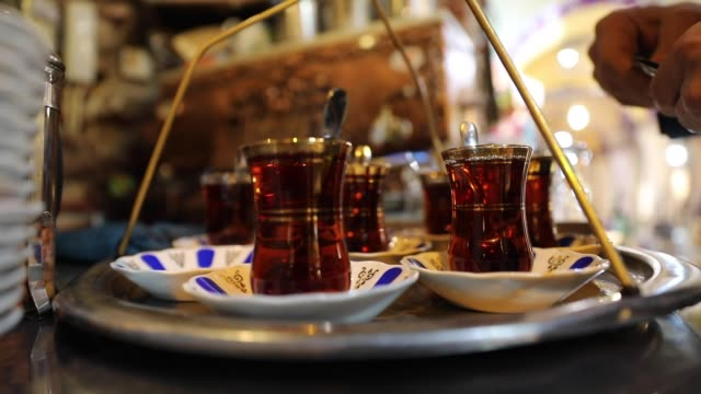 year-old cafe in istanbul's historic grand bazaar is adding to its rich heritage. ethem tezcakar kahveci serves thousands of cups of authentic... - 温かい飲み物点の映像素材/bロール