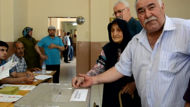 117yearold Ayse Uzkar casts her vote in the Turkish presidential and parliamentary elections at a polling station in Gaziantep on June 24 2018
