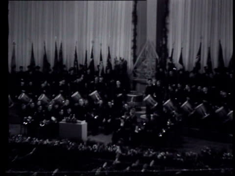 11dec1943 b/w montage in a hall in utrecht the twelfth anniversary of the nsb is celebrated various top officers give speeches the audience give the... - utrecht stock videos & royalty-free footage
