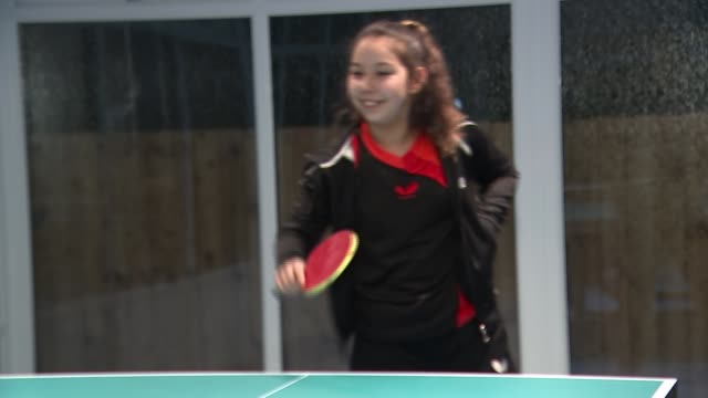 11yearold anna hursey prepares for commonwealth games wales cardiff int various of anna hursey playing table tennis during training/ anna hursey... - itv lunchtime news stock-videos und b-roll-filmmaterial