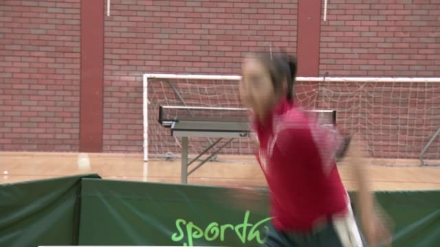 11yearold Anna Hursey prepares for Commonwealth Games WALES INT Various of Anna Hursey playing table tennis during training/ Anna Hursey interview...
