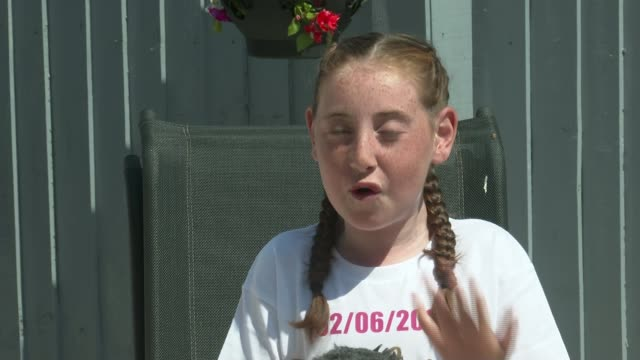 11yearold ffion laverick defies doctor's predictions and walks after being left paralysed as a toddler wales ext various of 11yearold ffion laverick... - intervento chirurgico a cuore aperto video stock e b–roll