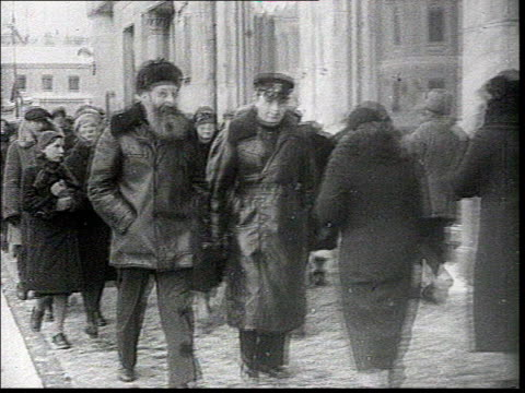 dec-1937 b/w montage election to the supreme soviet : opening of the polling stations, people enter polling stations, people in streets, vote scenes... - male likeness stock videos & royalty-free footage