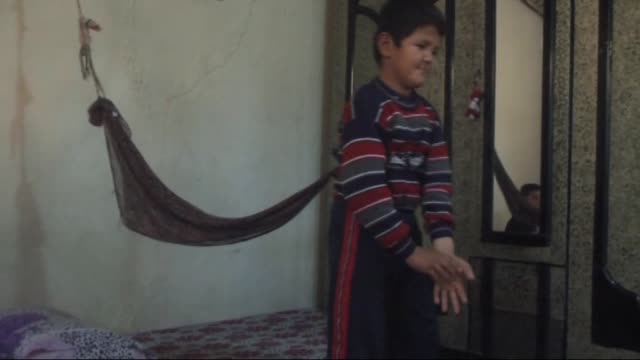 12yearold syrian mentallyill boy abdulkerim is tied up to a wall by his mother in order to prevent him from running away in reyhanli district of... - gefesselt stock-videos und b-roll-filmmaterial