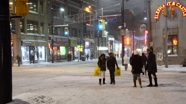 left pan of the winter lifestyle in the downtown district on december 13, 2013; in toronto, ontario, canada. people going out and about in the famous... - ontario canada stock videos & royalty-free footage