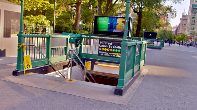 14th street union square subway entrance. public park. city life. - bus billboard stock videos & royalty-free footage