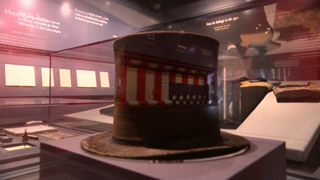 150th Anniversary of assassination of President Abraham Lincoln Top hat worn by Lincoln in glass case GVs Bloodstained flag on display