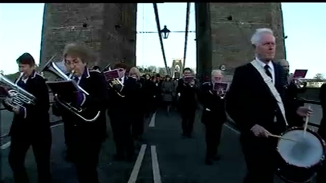 150th anniversary of clifton suspension bridge day marching band crossing the bridge sot tilt up to union jack flag - clifton suspension bridge stock videos and b-roll footage