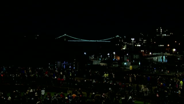 150th anniversary of clifton suspension bridge fireworks display various of crowd standing in park / - bristol england stock videos & royalty-free footage