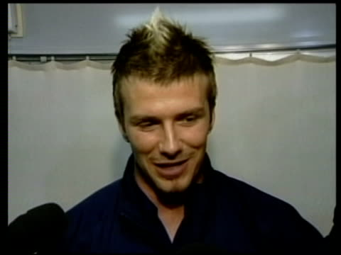 vídeos y material grabado en eventos de stock de jun-2002 england beats denmark in world cup 2002; david beckham interview / niigata, japan / audio - 2002