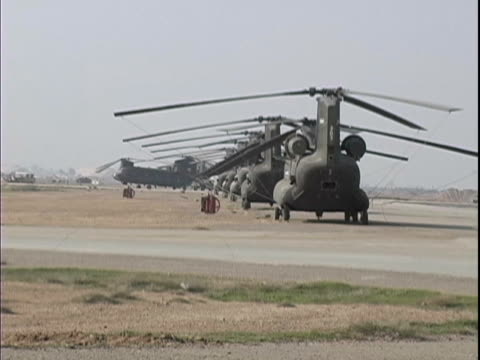 15th jan 2004 montage flight line footage of ch47 chinooks and uh60 blackhawks, female contractor driving off in 5 ton military truck / lsa anaconda,... - iraq stock-videos und b-roll-filmmaterial