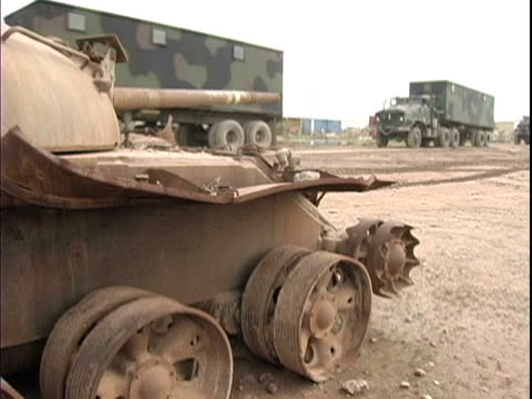 15th Jan 2004 MONTAGE Military convoy pulling out past blown up tank / LSA Anaconda Iraq / AUDIO