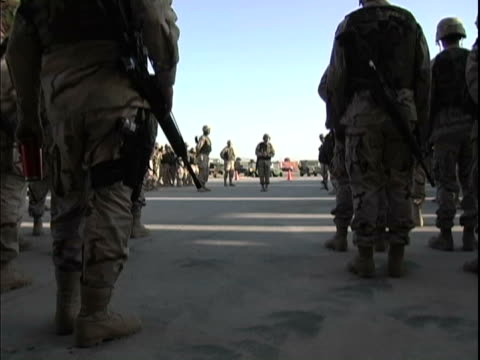 stockvideo's en b-roll-footage met 15th jan 2004 us soldiers during morning formation / fob speicher, iraq / audio - 2004
