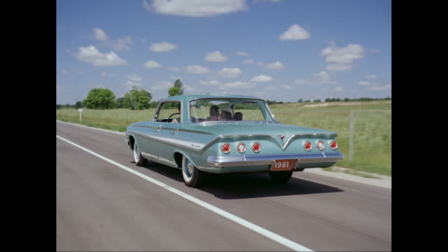 WS POV 1661s Chevrolet car moving on road / United States