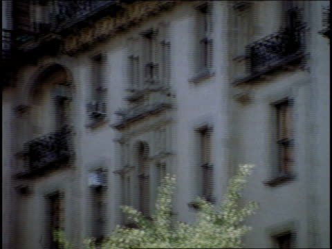 16mm broll shots of the dakota apartments from inside central park - john lennon stock videos & royalty-free footage