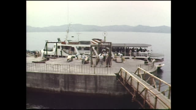 16mm film clip of gunkanjima nagasaki japan in 1970s one of the unesco world heritage sites - ishikawa prefecture stock videos and b-roll footage