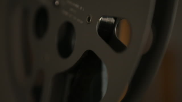 16mm film projector reel turns and stops - film projector stock videos & royalty-free footage