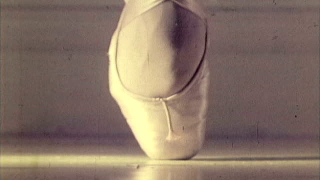 16mm footage close-up of a foot in a ballet pointe shoe. - ballet shoe stock videos & royalty-free footage