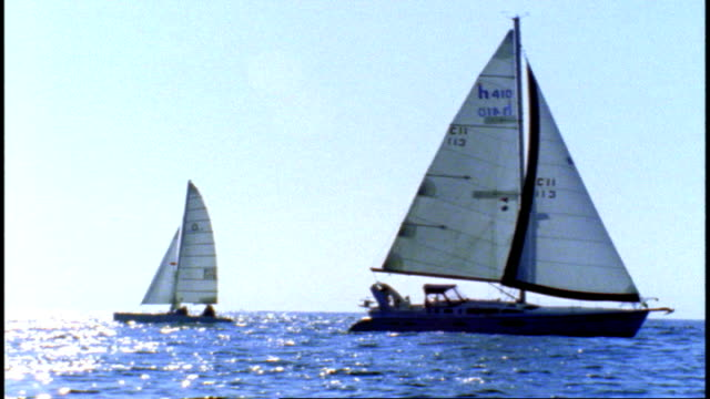 16mm footage of Sail Boats Sailing Past Each Other in Marina Del Rey California
