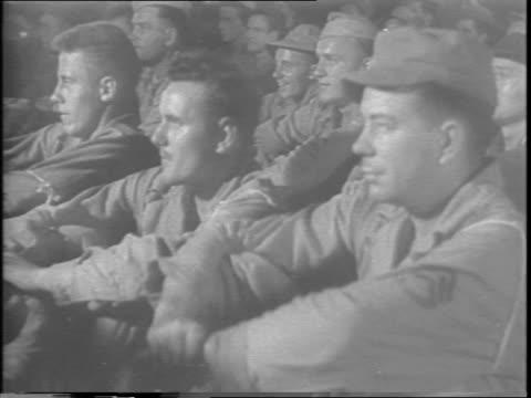 16mm versions of the latest movies are rushed to all fronts by plane as the entire movie industry cooperates to bolster entertainment and news hungry... - anno 1943 video stock e b–roll