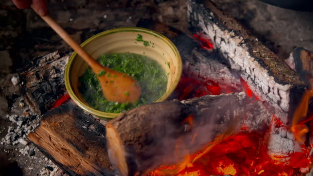 16th century-style spinach dish prepared on fire - fire natural phenomenon stock videos & royalty-free footage