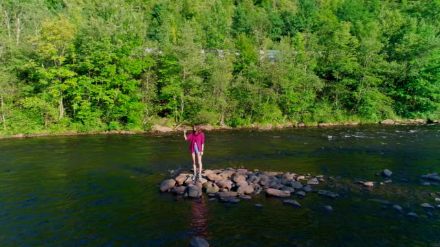 16-years-old teenager girl make selfie at the small island on the Lehigh River near by Jim Thorpe