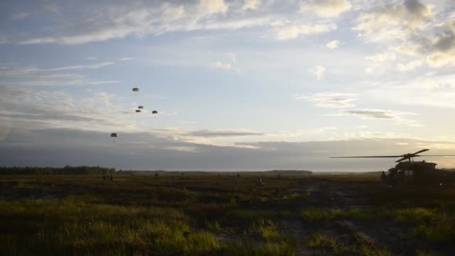 173rd airborne brigade jumping from 12 combat aviation brigade uh60 blackhawk helicopters as a part of continuing multinational training exercises at... - brigade stock videos & royalty-free footage