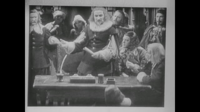 1938 17th century european colonists hold discussion around table - xvii° secolo video stock e b–roll