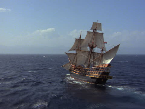 a 17th century galleon cruises through dark ocean waters with full sails. - 17th century stock videos & royalty-free footage