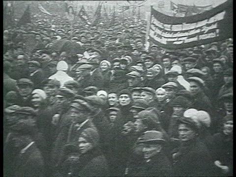 MONTAGE 17th October anniversary huge crowd marching in Leningrad / Leningrad Russia