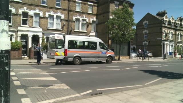 17yearold boy was stabbed to death in Peckham ENGLAND London Peckham EXT Police cordon tape across road and forensic tent at scene of stabbing Police...