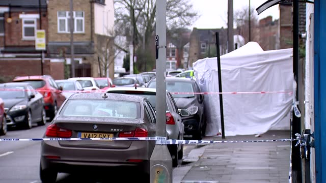 crime scene general views england london tottenham ext gvs crime scene / police officer and police car behind red police cordon tape at scene of... - jumpsuit stock videos and b-roll footage