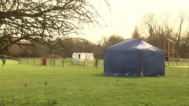 17yearold girl stabbed to death in east london england london romford harold hill ext blue forensic tent by playground - 刺傷事件点の映像素材/bロール