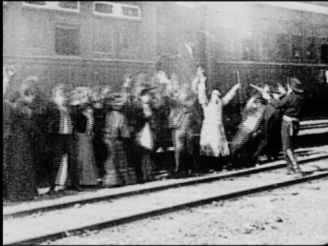 b/w 1800s bandits robbing train making passengers line up with hands raised next to train - stealing crime stock videos & royalty-free footage