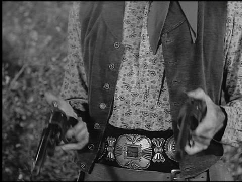 b/w 1800s close up cowboy's hands shooting + cocking pistols several times - cowboy stock-videos und b-roll-filmmaterial
