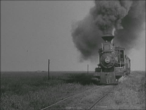 stockvideo's en b-roll-footage met b/w 1800s close up steam train passes in countryside - stoomtrein