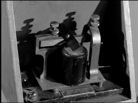 b/w 1800s close up tilt down from telegraph to hands writing out message on paper - telegram stock videos and b-roll footage