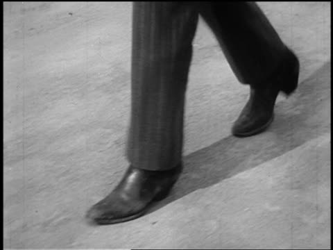 b/w 1800s close up tracking shot cowboy's feet in boots walking in dirt (shootout) - footwear stock videos & royalty-free footage
