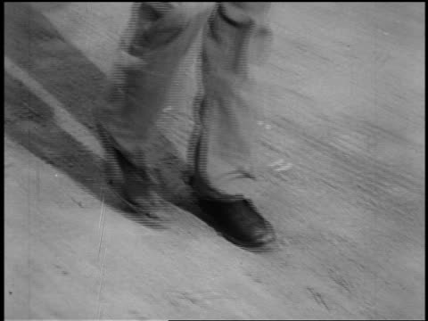 b/w 1800s close up tracking shot cowboy's feet in boots walking in dirt (shootout) - cowboy stock videos & royalty-free footage