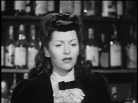 B/W 1800s close up woman in bar looking worried