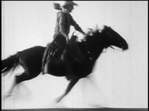 b/w 1800s cowboy (william s. hart) riding running horse on hilltop of plain - cowboy stock videos & royalty-free footage