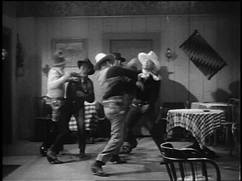 b/w 1800s group of cowboys fighting in bar (tex ritter, dave o'brien) - fight stock videos & royalty-free footage
