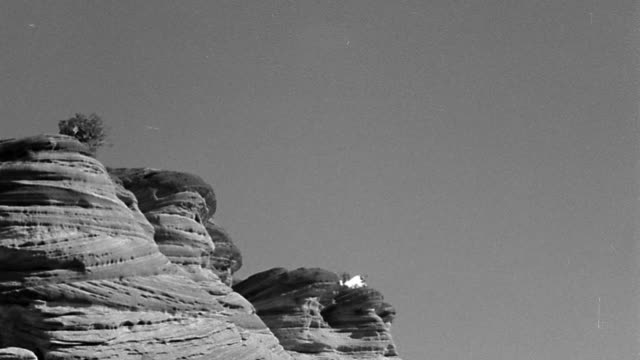 b/w 1800s low angle wide shot smoke signals billowing from top of cliffs - distant stock videos & royalty-free footage