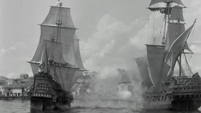 1800s reenactment wide shot two pirate galleons exchanging gunfire in harbor - battle stock-videos und b-roll-filmmaterial