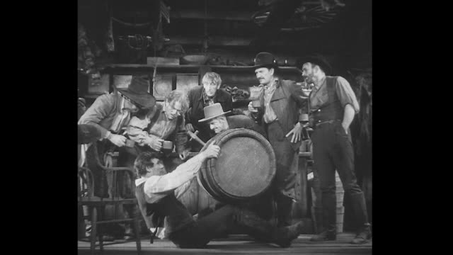 1830s a young abraham lincoln drinks out of a beer barrel before spitting out liquid and explaining he doesn't drink - エイブラハム・リンカーン点の映像素材/bロール