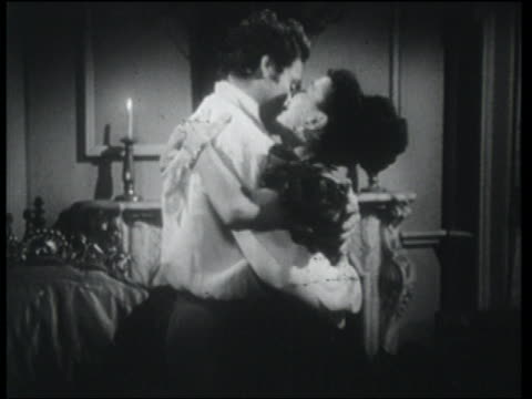 B/W 1830s dolly shot in to couple (Robert Clarke & Catherine McLeod) hugging then kissing indoors / woman crying