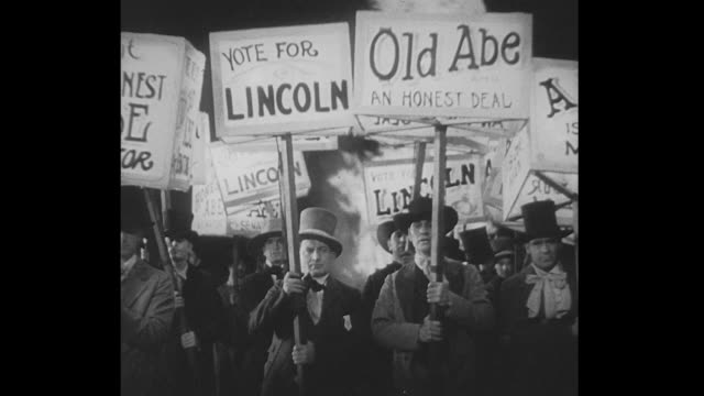 1850s abraham lincoln and his supporters march in political parade - エイブラハム・リンカーン点の映像素材/bロール