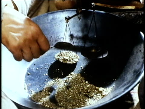 1850s reenactment cu gold being placed on scale with spoon, usa, audio - reenactment stock videos & royalty-free footage